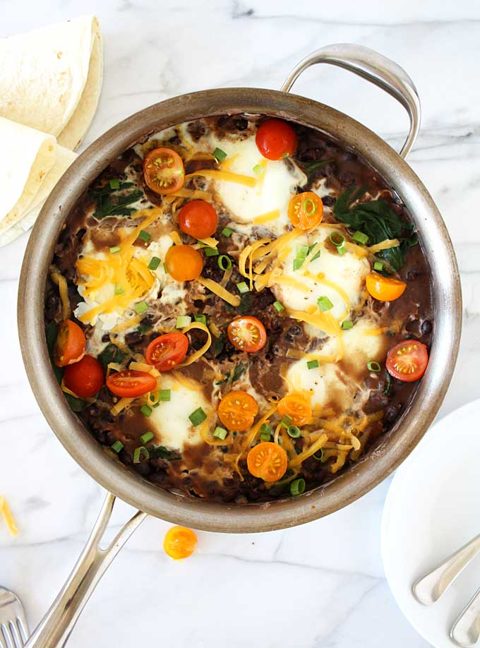 Southwest Refried Black Beans with Spinach & Eggs | thekitchenpaper.com