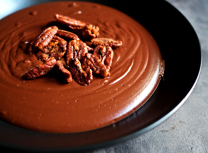 Warm Cocoa Pudding with Smoked Paprika Candied Pecans | thekitchenpaper.com